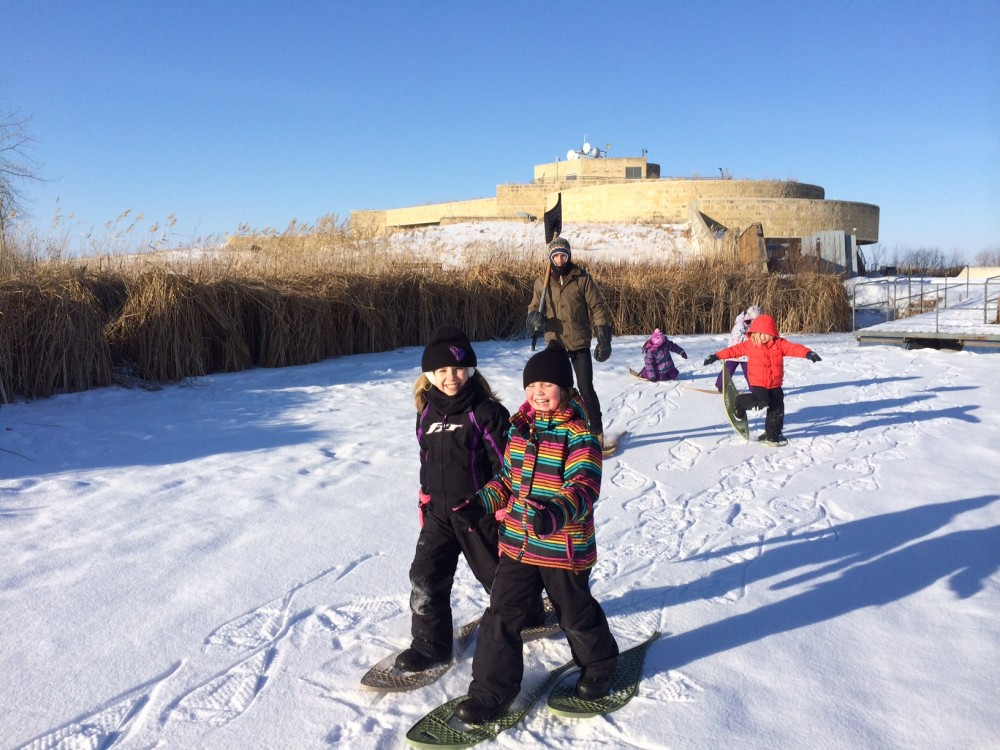 Kids snowshoeing at the marsh